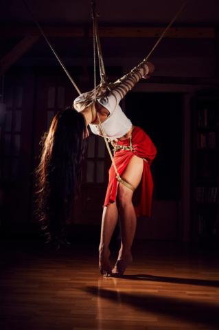 Strappado arm binder red skirt Kinbaku Photography